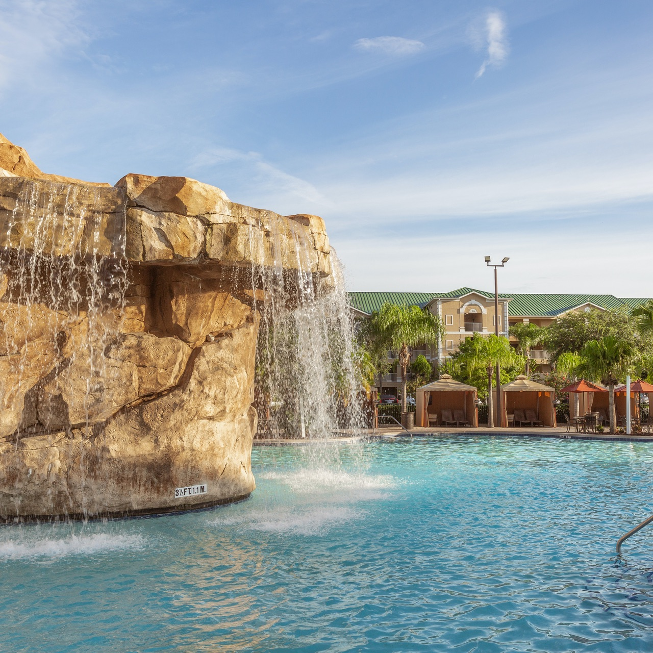 Pool area with grotto waterfall at Mystic Dunes